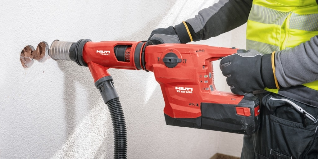 Cordless combihammer with dust removal solution